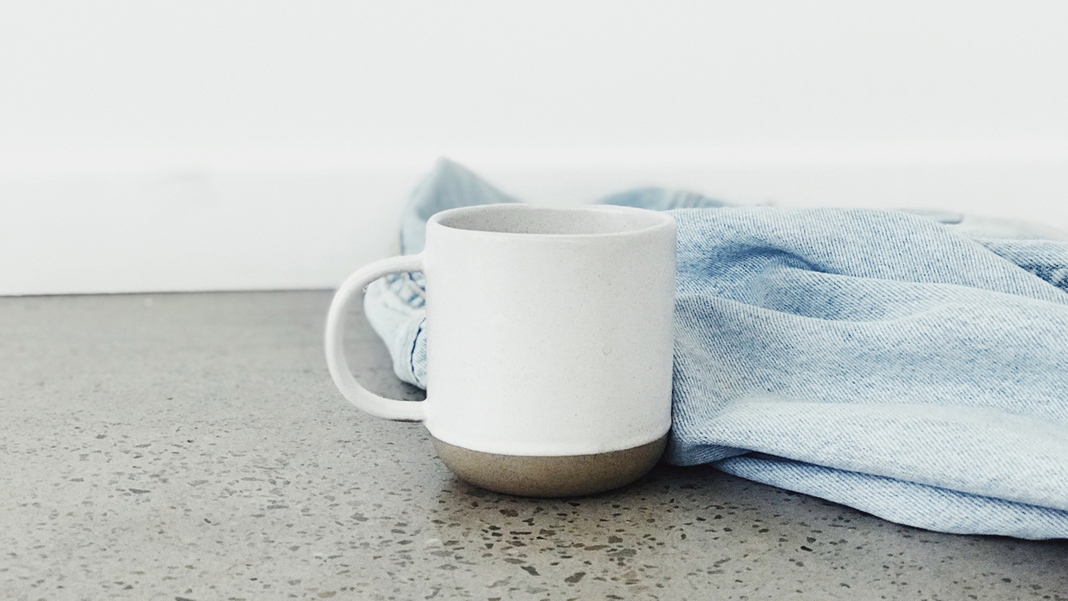Coffee cup and denim jacket